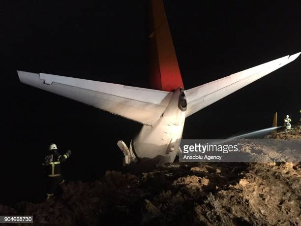 Pegasus airplane carrying 162 passengers is seen stuck in mud as it skidded off the runway after landing in Trabzon Airport Turkey early Sunday on...