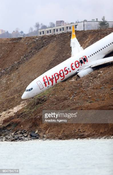 Pegasus airplane is seen stuck in mud as it skidded off the runway after landing in Trabzon Airport Turkey early Sunday on January 14 2018 162...