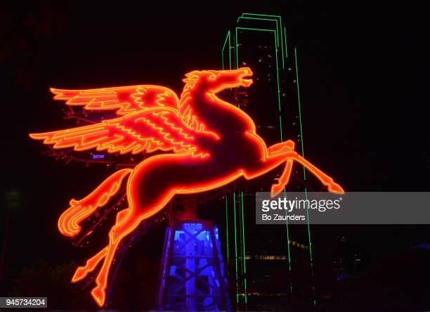 Pegasus, Dallas' flying red horse, as seen against the Bank of America Tower, in Dallas, Texas..