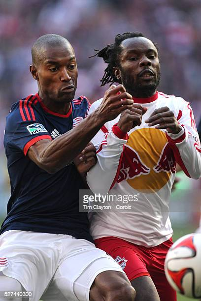 Pegguy Luyindula New York Red Bulls is challenged by Jose Goncalves New England Revolution during the New York Red Bulls Vs New England Revolution...