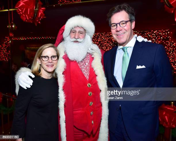 Peggy Conway Santa Claus and Joe Conway attend A Christmas Cheer Holiday Party 2017 Hosted by George Farias and Anne and Jay McInerney at The Doubles...