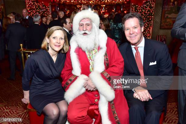 Peggy Conway Santa Claus and Joe Conway attend George Farias Anne Jay McInerney Host A Holiday Party at The Doubles Club on December 13 2018 in New...