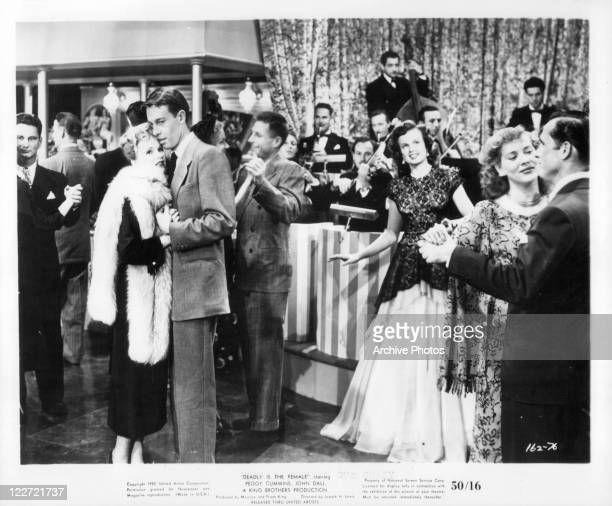 Peggy Cummins dances with John Dall in a scene from the film 'Gun Crazy' 1950