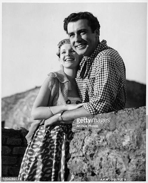 Peggy Cummins embraces Richard Greene in a scene from the film 'If This Be Sin' 1949