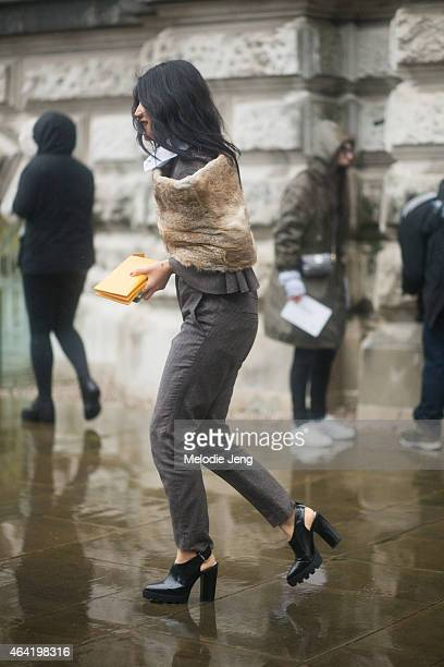 Peggy Gould enters the Topshop show during London Fashion Week Fall/Winter 2015/16 at Tate Britain on February 22 2015 in London England