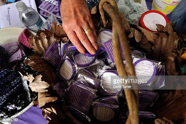 Peggy Keyes reaches for awareness bracelets at a booth for the Pancreatic Action Network during a memorial service for actor Patrick Swayze on...