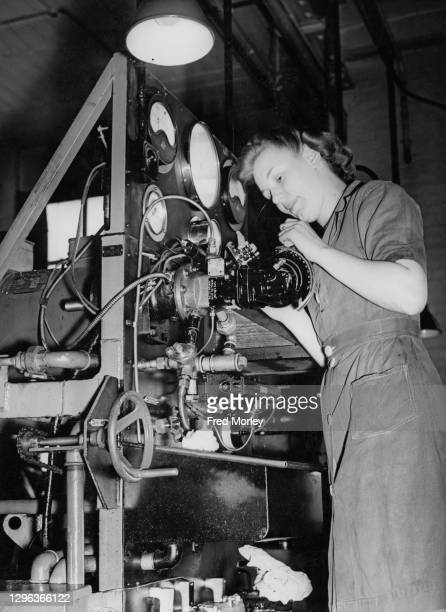 Peggy Kind carries out maintenance work on a Rotol Constant-Speed propeller unit that will be equipping the Hawker Hurricane, Supermarine Spitfire...