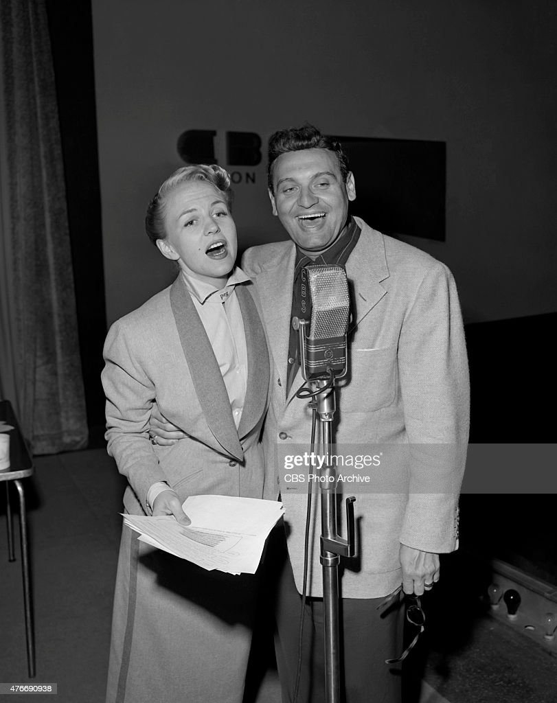 Peggy Lee, American jazz and popular music singer, and star of CBS Radio series, The Peggy Lee Show broadcast from CBS Studios, New York. Pictured: (L to R) Peggy Lee, Frankie Laine. Image dated June 26, 1952.