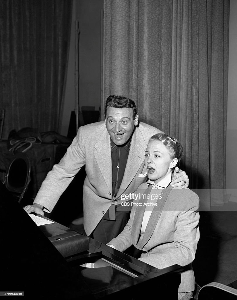 Peggy Lee, American jazz and popular music singer, and star of CBS Radio series, The Peggy Lee Show broadcast from CBS Studios, New York. Pictured: (L to R) Frankie Laine, Peggy Lee. Image dated June 26, 1952.