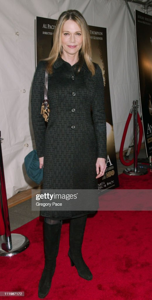 Peggy Lipton, wearing a coat designed by Donna Karan