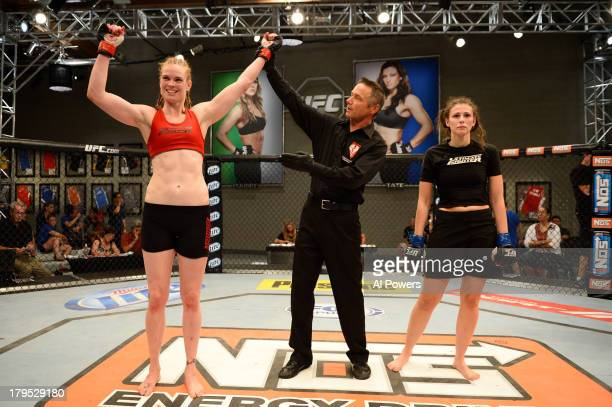 Peggy Morgan celebrates after defeating Bethany Marshall in their elimination fight during filming of season eighteen of The Ultimate Fighter on May...