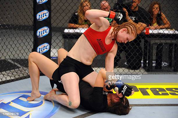 Peggy Morgan punches Bethany Marshall in their elimination fight during filming of season eighteen of The Ultimate Fighter on May 29 2013 in Las...