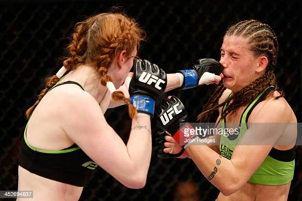 Peggy Morgan punches Jessamyn Duke in their women's bantamweight fight during The Ultimate Fighter season 18 live finale inside the Mandalay Bay...