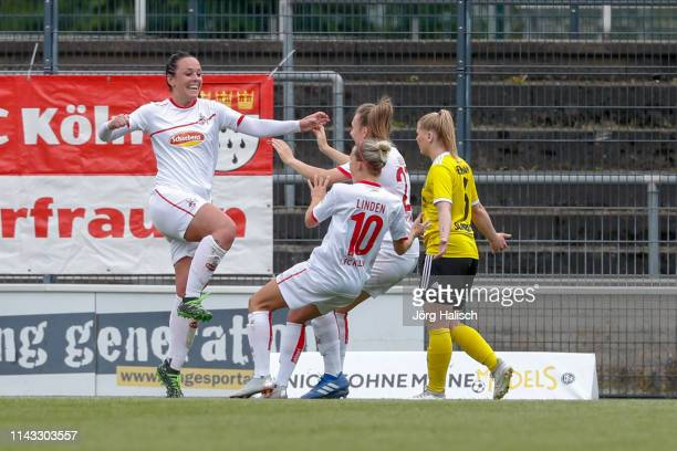 Peggy Nietgen and Anna Isabelle Linden and Kristina Hild of Koeln celebrate their goal during the women's second Bundesliga match between 1FC Koeln...