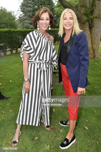 Peggy Siegal and Candace Bushnell attend the East Hampton Summer Screening Of The Wife at Guild Hall on July 22 2018 in East Hampton New York