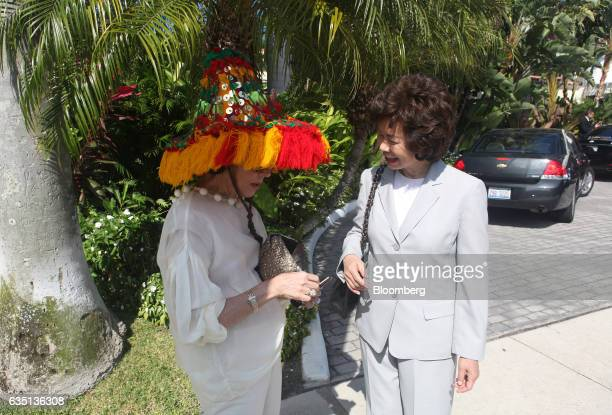 Peggy Siegal and Elaine Chao stand outside the Brazilian Court hotel in Palm Beach Florida US on Saturday Feb 11 2017 There were camels in the sand a...