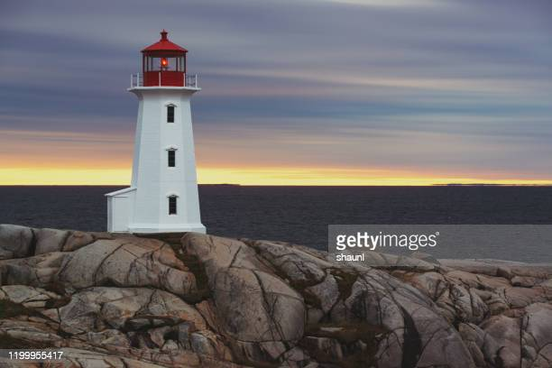peggy's cove lighthouse - lighthouse stock pictures, royalty-free photos & images