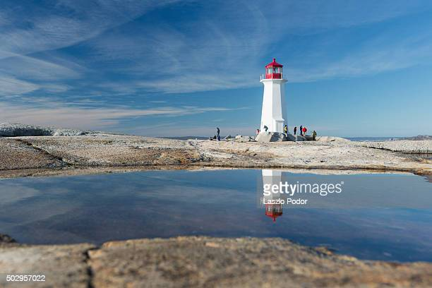 peggy's cove lighthouse reflection - nova scotia stock pictures, royalty-free photos & images
