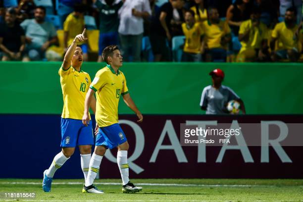 Peglow of Brazil celebrates with teammate after scoring a goal during the FIFA U17 Men's World Cup Brazil 2019 match Italy and Brazil at Olimpic...