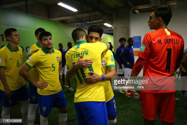 Peglow of Brazil hugs Yan Couto prior to the FIFA U17 World Cup Brazil 2019 semifinal match between France and Brazil at Estadio Bezerrao on November...