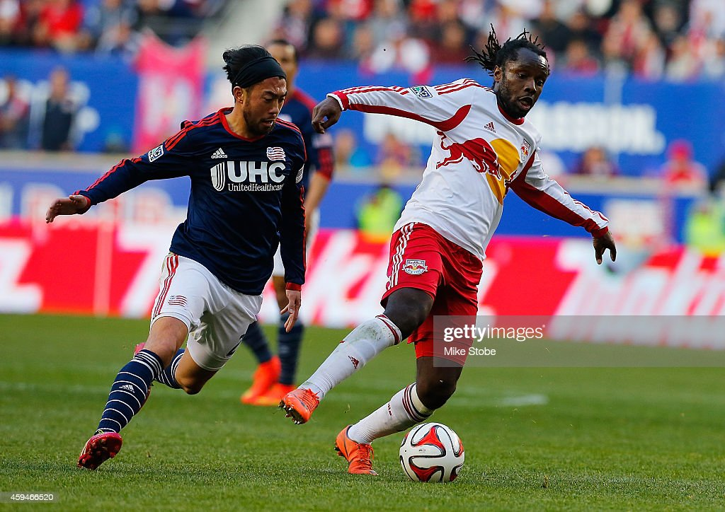 Peguy Luyindula #8 of New York Red Bulls plays the ball against the New England Revolution during the Eastern Conference Final - Leg 1 at Red Bull Arena on November 23, 2014 in Harrison, New Jersey. Revolution defeated the Red Bulls 2-1.