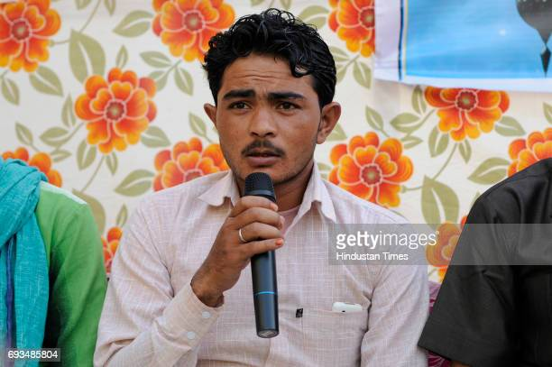 Pehlu Khan's son Irshad speaks during an Iftar gettogether at Students Islamic Organisation of India on June 7 2017 in New Delhi India Pehlu Khan's...