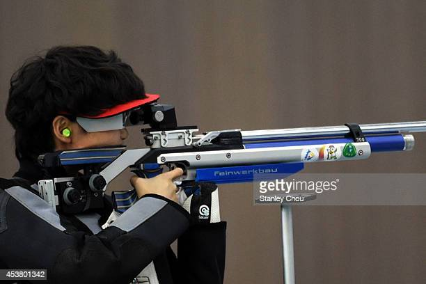 Pei Ruijiao of China shoots during the 2014 Summer Youth Olympic Games Day 3 of the Girls 10m Air Rifle Final at the Fangshan Shooting Hall on August...