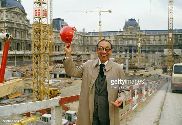 IM Pei the architect of the Louvre's glass Pyramid Entrance stands at the entrance's construction site