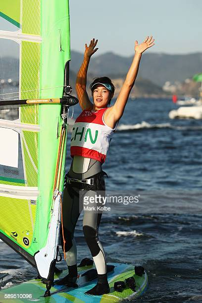 Peina Chen of China celebrates after finishing second overall in the Women's RSX class on Day 9 of the Rio 2016 Olympic Games at the Marina da Gloria...