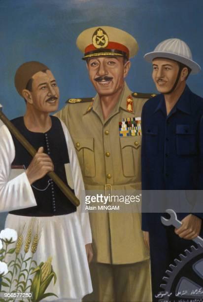 Peinture à l'effigie du président Anouar elSadate entouré d'un ouvrier et d'un paysan dans les années 1970 en Egypte