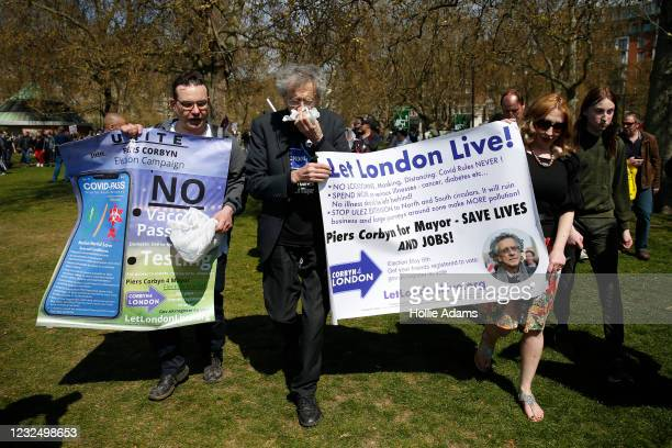 """Peirs Corbyn uses a tissue during a """"Unite For Freedom"""" anti-lockdown demonstration held to protest against the use of vaccine passports in the..."""