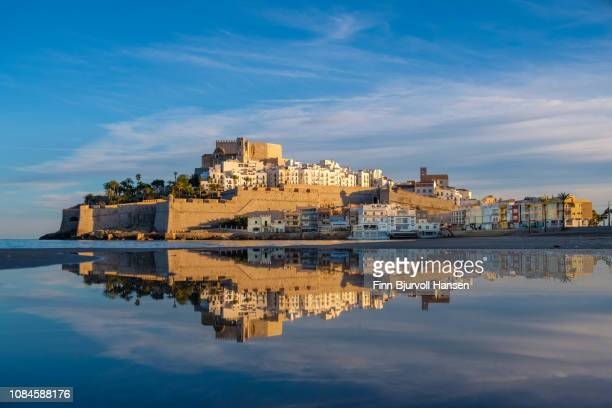 peñiscola fortress - castillo de peñíscola spain  - with reflection in a small pond at the beach in the golden hour - finn bjurvoll stock photos and pictures