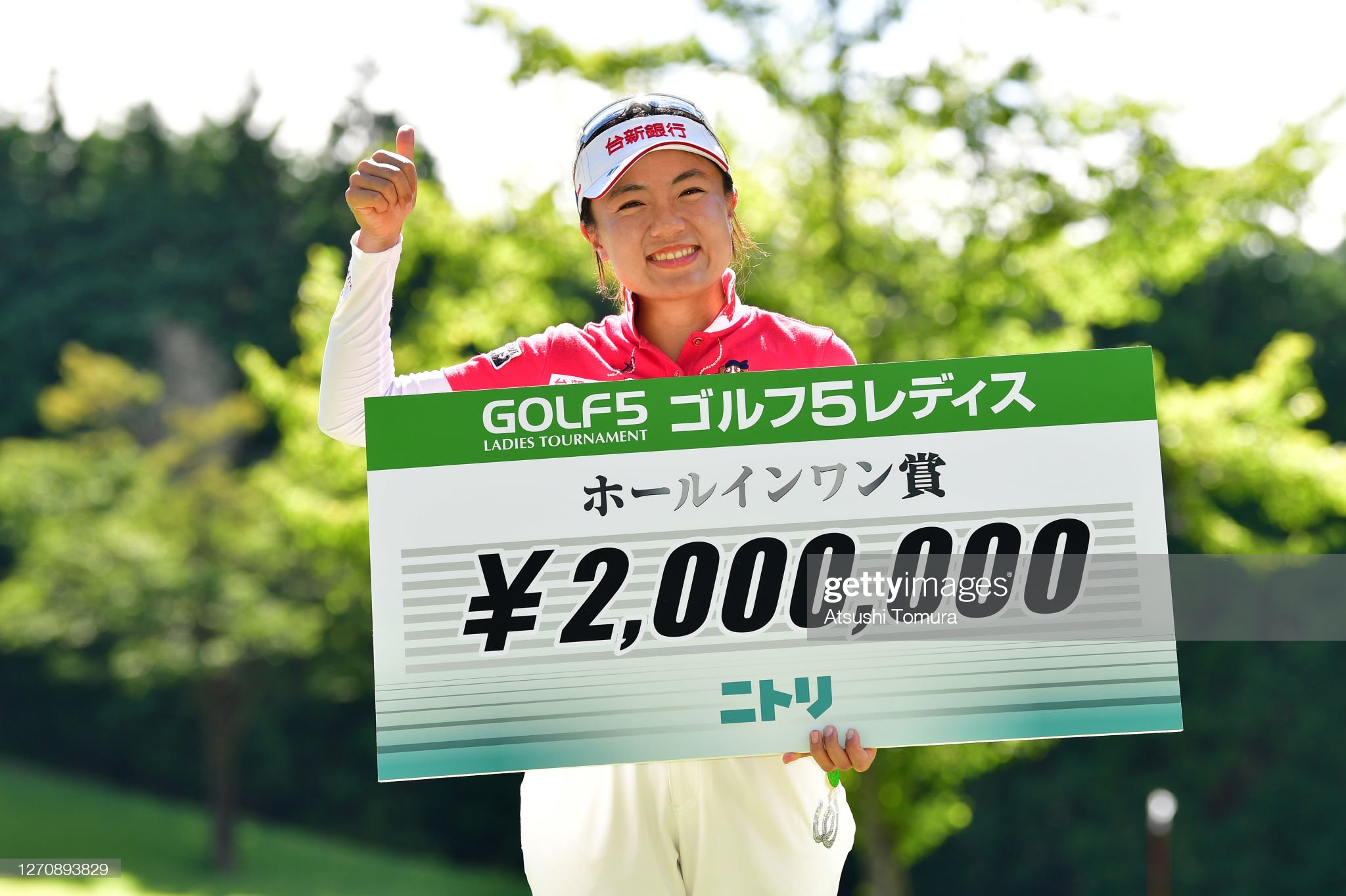 https://media.gettyimages.com/photos/peiying-tsai-of-chinese-taipei-poses-after-making-a-holeinone-on-the-picture-id1270893829?s=2048x2048
