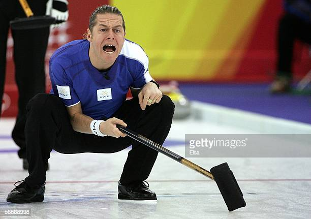 Peja Lindholm of Sweden directs his teammates during the preliminary round of the men's curling between Sweden and Finland during Day 7 of the Turin...