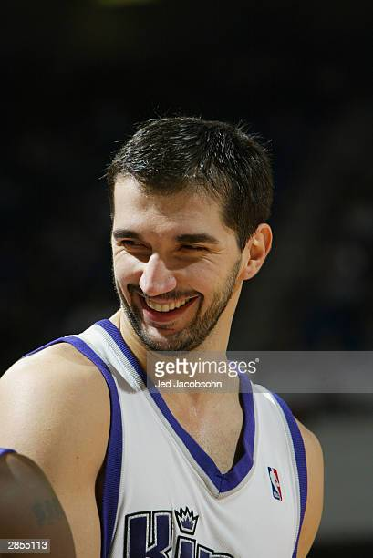 Peja Stojakovic of Sacramento Kings smiles during the game against the Portland Trail Blazers at Arco Arena on December 21 2003 in Sacramento...