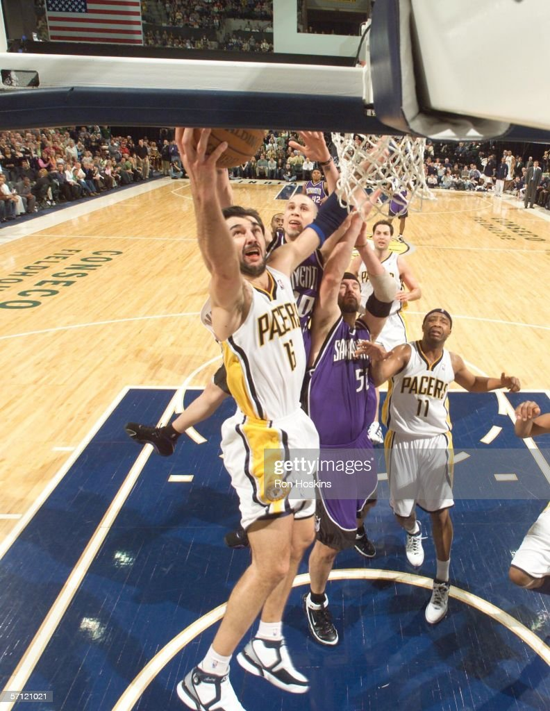 Peja Stojakovic of the Indiana Pacers shoots over Brad