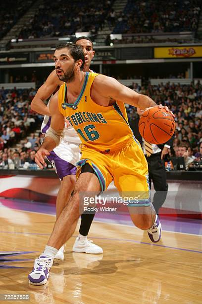 Peja Stojakovic of the New Orleans/Oklahoma City Hornets gets past Kevin Martin of the Sacramento Kings on October 24 2006 at ARCO Arena in...