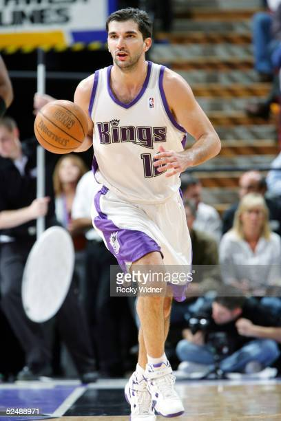 Peja Stojakovic of the Sacramento Kings brings the ballup court against the Philadelphia 76ers on March 28 at Arco Arena in Sacramento California...