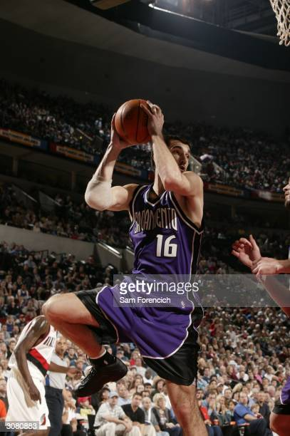 Peja Stojakovic of the Sacramento Kings shoots during a game against the Portland Trail Blazers March 12, 2004 at the Rose Garden Arena in Portland,...