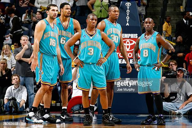 Peja Stojakovic Tyson Chandler Chris Paul David West and Bobby Jackson of the New Orleans Hornets stand on the court during the game against the...