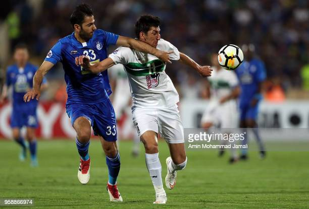 Pejman Montazeri of Esteghlal and Morteza Tabrizi of Zobahan in action during AFC Champions League match between Esteghlal FC and Zobahan at Azadi...