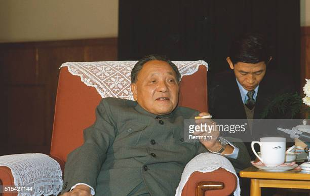Peking, China: Chinese leader Deng Xiaoping sits in a chair and enjoys a cigarette.
