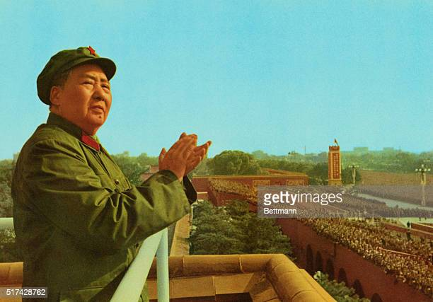 Peking, China: General view of Mao Tse-Tung, Chinese Party Communist Chairman, applauding as he stands on a platform over looking a crowd.