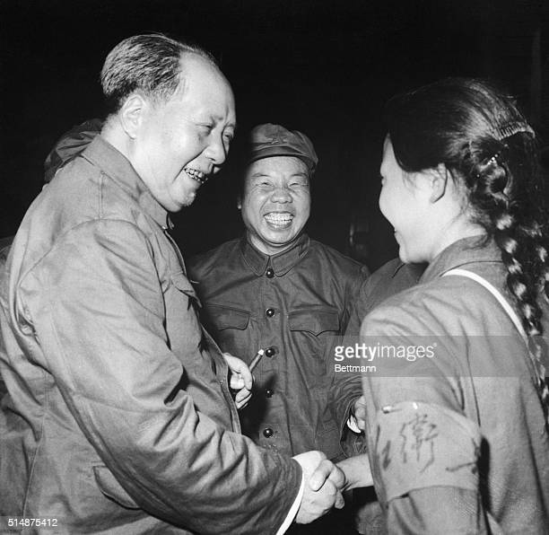 Communist China's Chairman Mao TseTung has a big smile and a hearty handclasp for a pigtailed girl member of the Red Guard in Peking recently A...