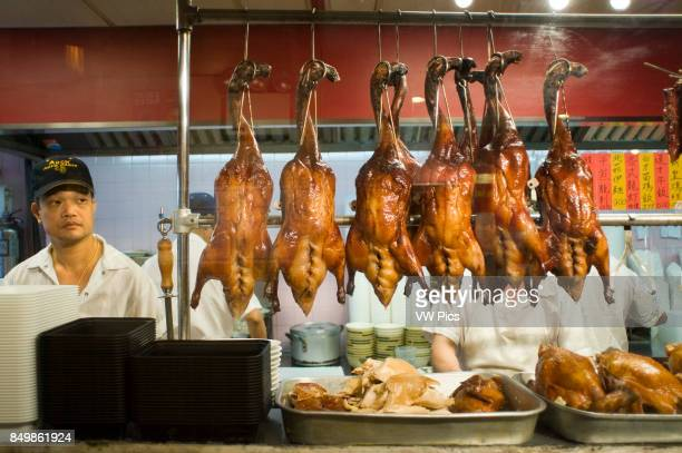 Peking Ducks on Display in Chinatown Typical Asian food restaurant in Chinatown Lacquered ducks hanging in the kitchen