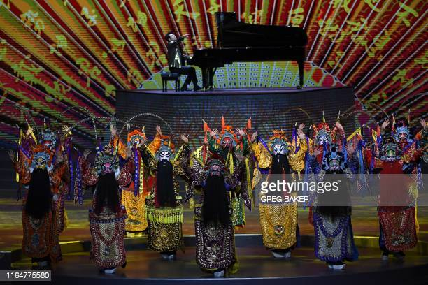 Peking Opera dancers and pianist Lang Lang perform during the opening ceremony of the 2019 Basketball World Cup in Beijing on August 30 2019