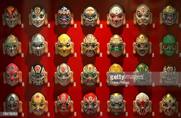 Peking Opera facial masks are displayed at the Century Monument Temple Fair on February 6 2008 in Beijing China Beijing residents keep the tradition...