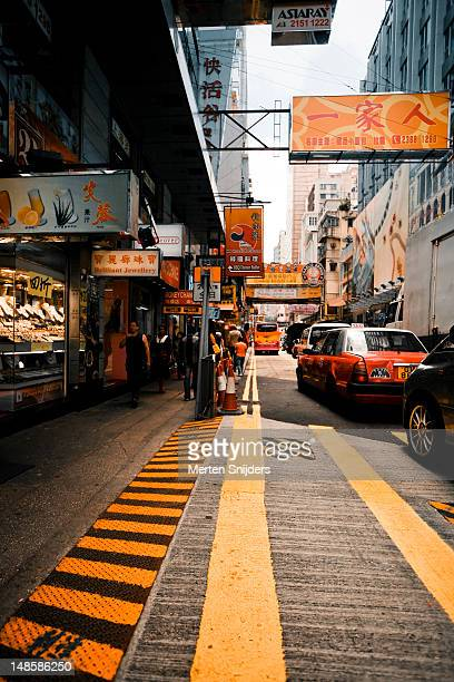 peking road pedestrian crossing and shops. - merten snijders stock pictures, royalty-free photos & images
