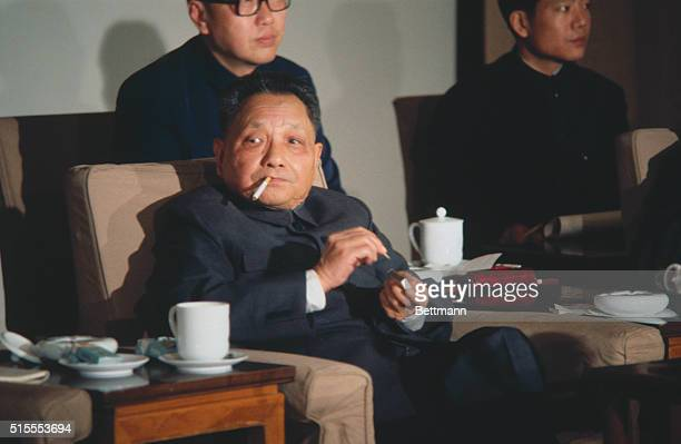 Peking: Vice Premier Deng Xiaoping of China breathes smoke of cigarette out at a press-conference, here 1/5.