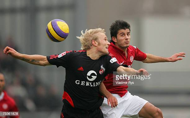 Pekka Lagerblom of Cologne and Serkan Calik of Essen vie for a header during the Second Bundesliga match between Rot Weiss Essen and 1FC Cologne at...